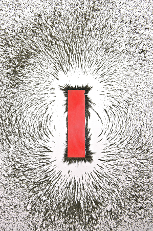 bar magnet: Bar magnet with iron filings showing magnetic field pattern