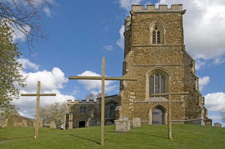 eastertime: An English Parish Church with 3 crosses outside at Easter time Stock Photo