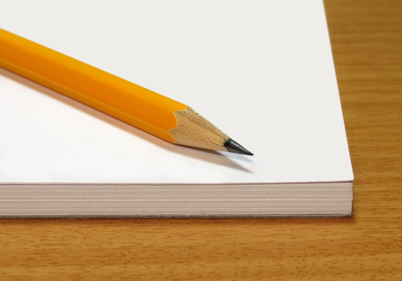 yellow notepad: Note pad with a yellow pencil on a wooden table