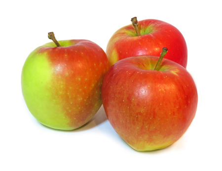 Group of ripe, red and green coloured apples, isolated on a white background
