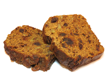 Two slices of freshly baked home made tea loaf cake, isolated on a white background