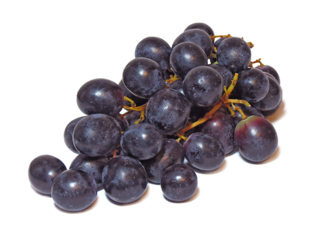 Bunch of dark grapes isolated on a white background