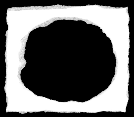 Torn white paper with a ripped hole isolated on a black background showing the fibers