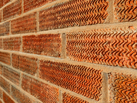 old brick wall:  close up of a wall showing the mortar and the texture of the brick
