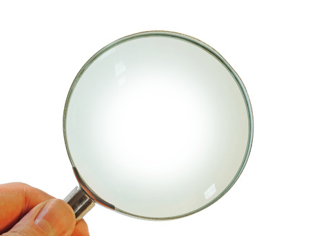 Hand holding a magnifying glass, isolated on a white background
