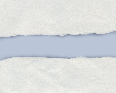 Torn paper edge showing a light blue background with copy space