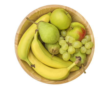 Group of healthy fresh fruit in a wooden bowl, isolated on a white background