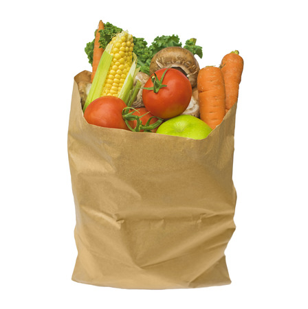 Healthy fruit and vegetables in a brown paper bag, isolated on a white background Reklamní fotografie