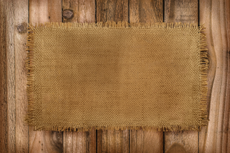 Rustic background of Burlap material on a wooden table with copy space Stok Fotoğraf - 92366179