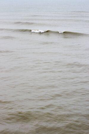 Waves on brown stromy sea