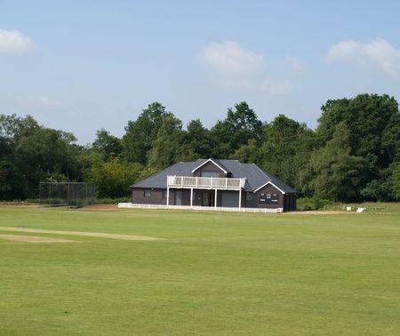 Cricket pavillion and pitch photo