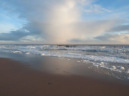 unspoilt: Clouds over a rough sea from the beach