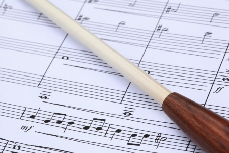 baton: Conductor s Baton and Music Score Stock Photo