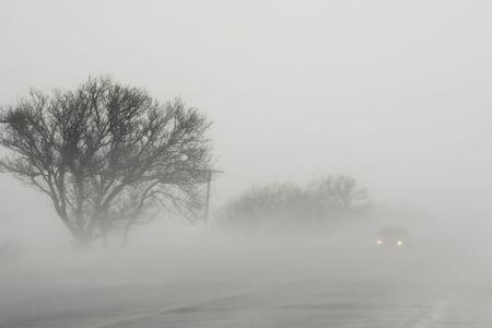 Blizzard on road among fields of Crimea Stock Photo