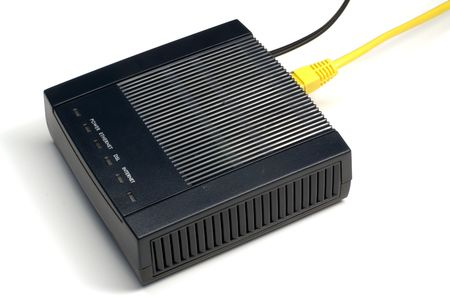 adsl: Black ADSL modem with connected LAN and phone wires