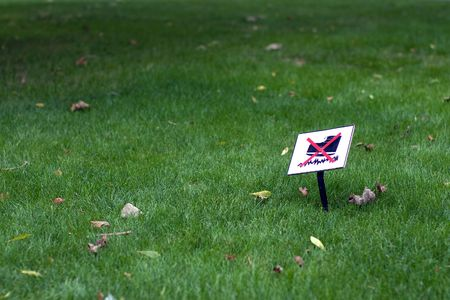 prohibitive: The ban on the lawn with the prohibitive sign