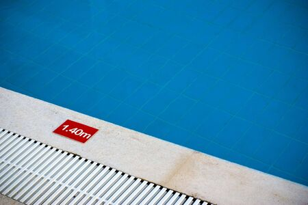 Pool depth sign at the edge of swimming pool Stock Photo - 6364013