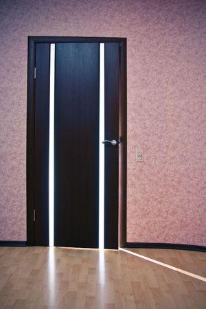 Beam of light from ajar wooden door Stock Photo - 6395018