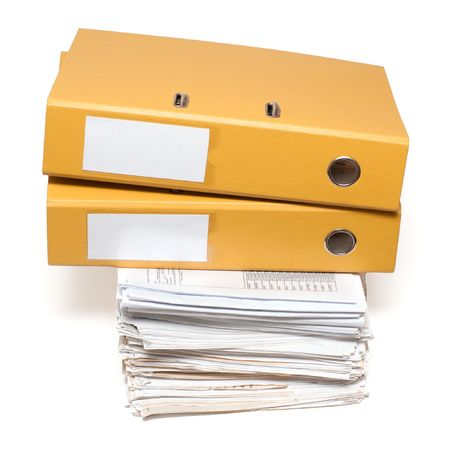 Two folders lie on the pile of documents photo