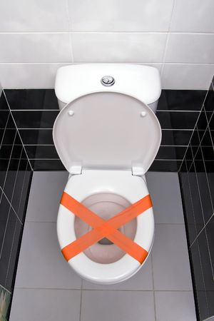 Cross made from adhesive tape, the sign Do not throw trash in toilet Stock Photo - 6429504