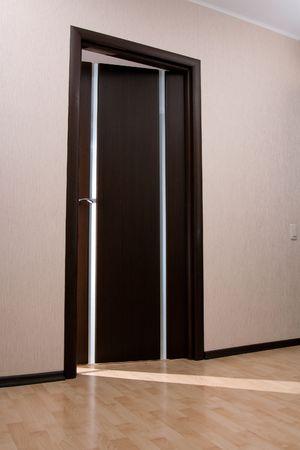 Beam of light from ajar wooden door photo