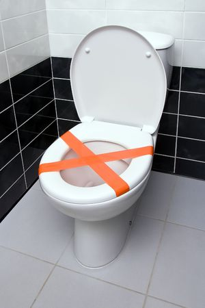 Cross made from adhesive tape, the sign Do not throw trash in toilet photo