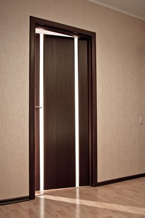 Beam of light from ajar wooden door Stock Photo - 6429544