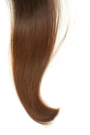 lock of hair: Lock of silken brown hair isolated on white background