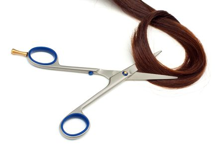 hairdressing scissors: Scissors and lock of hair isolated on white background Stock Photo