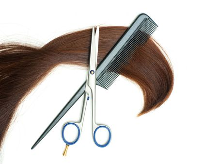 haircutting: Scissors, hairbrush and lock of hair isolated on white background