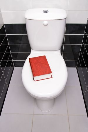 watercloset: Red book is on the water-closet lid