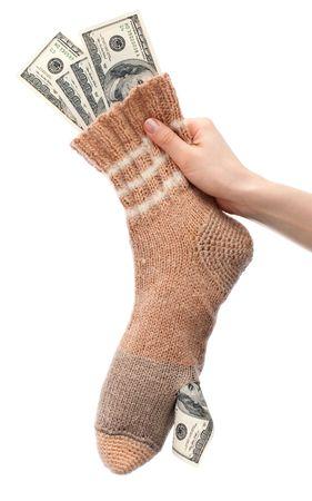 Dollars keeping in holed sock isolated on white background Stock Photo - 6530024