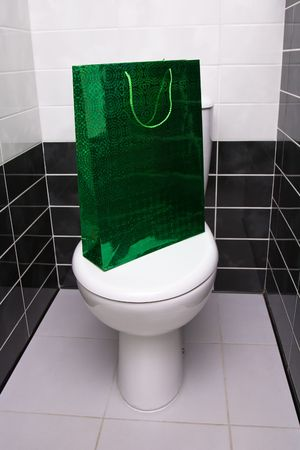 watercloset: Green package is on the water-closet lid