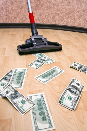 Vacuum cleaner cleaning monetary dust on the floor photo