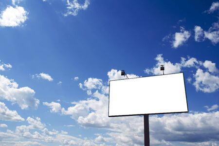 adboard: Billboard and a brilliant blue sky with clouds. Stock Photo