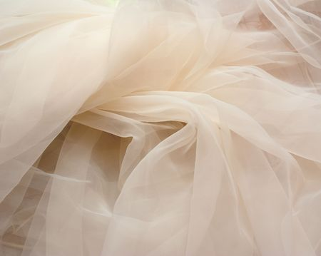 The part of crumpled ivory tulle