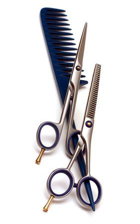 Professional hair scissors on the handle rake