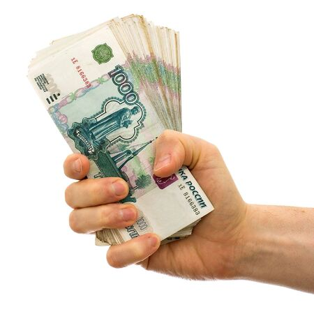 Hand holding boundle of roubles isolated on white background photo