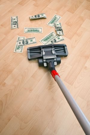 Vacuum cleaner cleaning monetary dust on the floor Stock Photo - 6679492