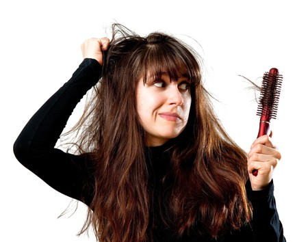 bad hair day: Frustrated young woman having a bad hair day Stock Photo
