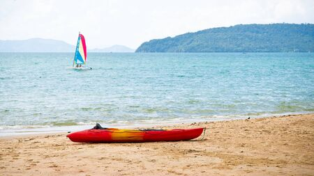 sailingboat: Sailing-boat in the sea and kayak on the beach
