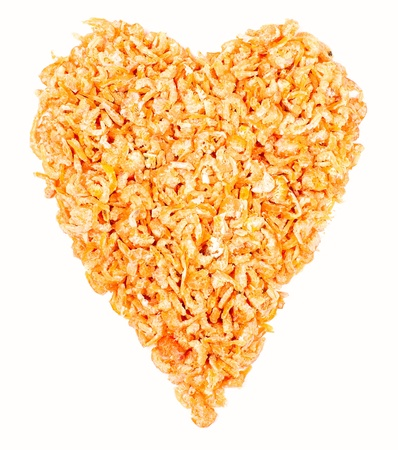 Heart made of dried shrimps, isolated on a white background Stock Photo - 9356168