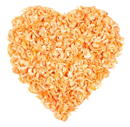 Heart made of dried shrimps, isolated on a white background photo