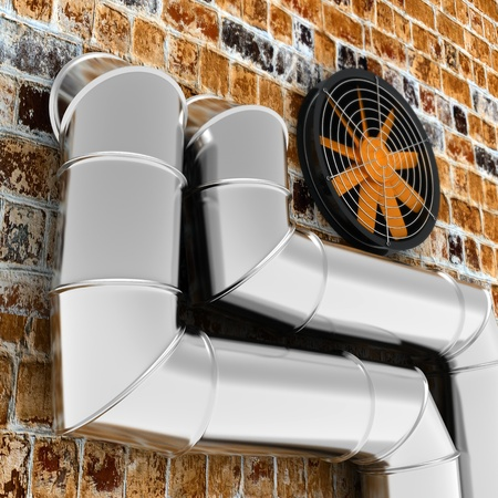 Metal pipes and ventilator on the brick wall photo
