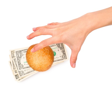 Hand stealing a money-stuffed burger, isolated on the white background photo