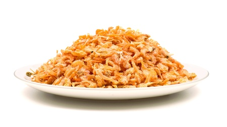 Heap of dried shrimps on a white plate Stock Photo - 9517772