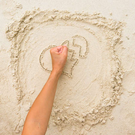 The fist breaking the sand heart photo