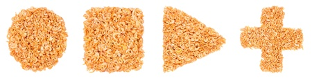 Geometrical figures made of dried shrimps, isolated on a white background photo