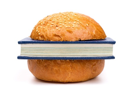 book concept: Sandwich with a book isolated on a white background