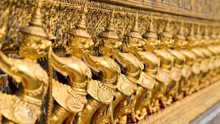 The wall with statues of golden garuda, Wat Phra Keo, Bangkok, Thailand photo